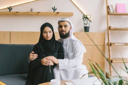 muslim couple embracing
