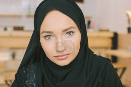 Photo for Close- up portrait of muslim woman in hijab looking at camera - Royalty Free Image