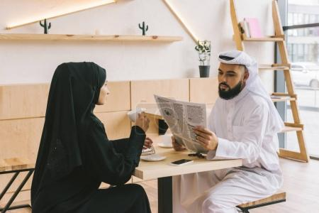 Couple spending time together in cafe
