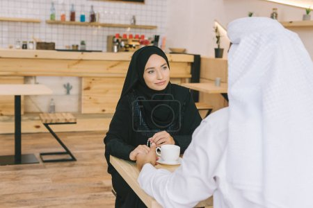 muslim couple having date in cafe