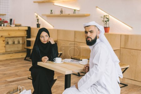 muslim couple drinking coffee