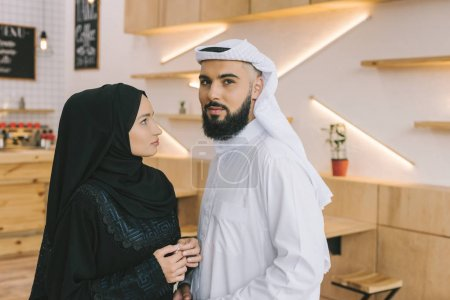 muslim couple in cafe