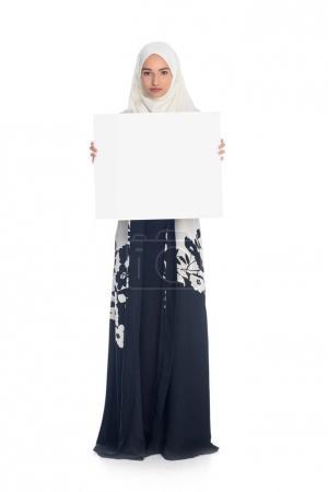 muslim woman holding blank board