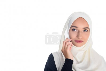 muslim woman talking by phone