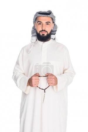 Muslim man with prayer beads