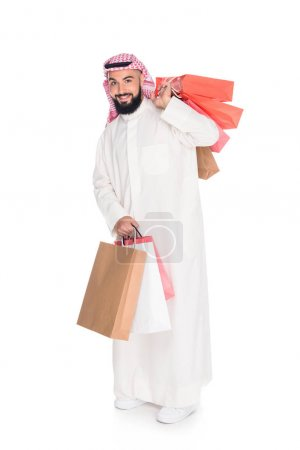 muslim man with shopping bags