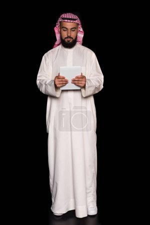muslim man with digital tablet