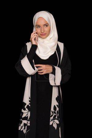 muslim woman talking by phone