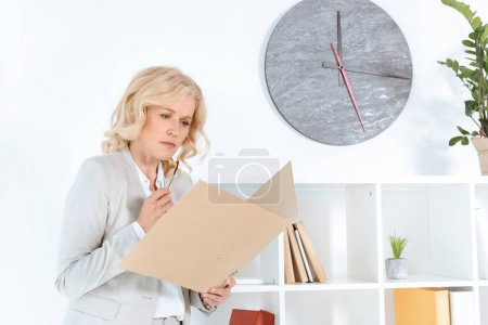 businesswoman with folder in office