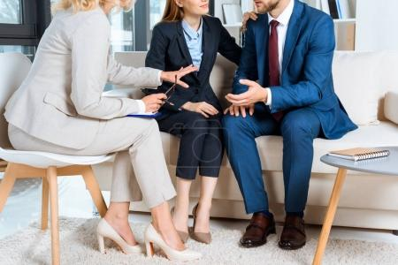 Young couple and psychologist