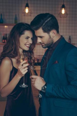 couple with glasses of champagne