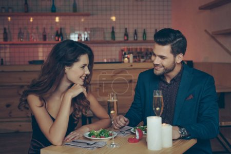 Photo for Young couple in love having romantic dinner together in restaurant - Royalty Free Image
