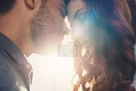 Photo for Close up view of sensual couple in love standing head to head - Royalty Free Image