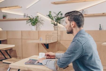 caucasian man in cafe