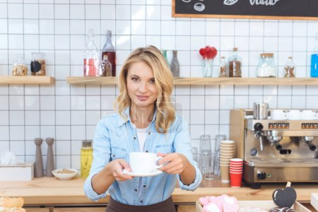 barista holding cup of coffee