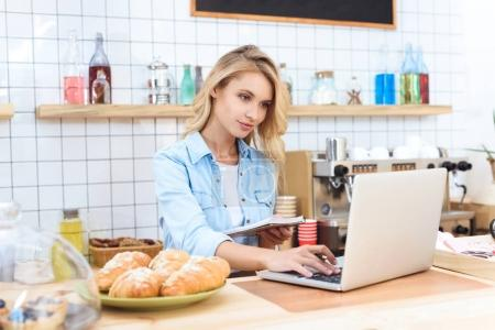 cafe owner using laptop