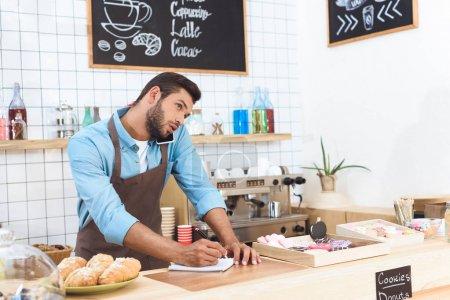 cafe owner taking notes