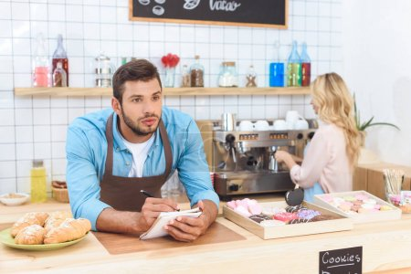 couple working together in cafe