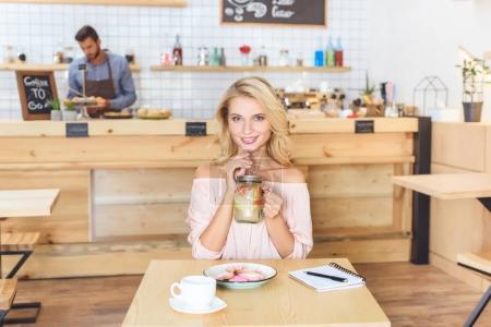 woman drinking lemonade in cafe