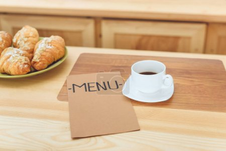 cup of coffee and menu