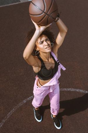african-american woman throwing basketball