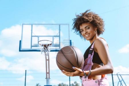 african-american woman holding basketball