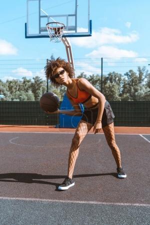 african-american woman dribbling basketball