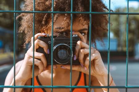 sportive woman taking picture with camera