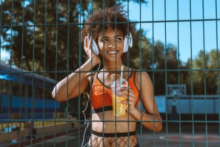 african-american woman listening to music in headphones