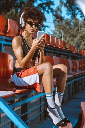 Athletic african-american woman in headphones