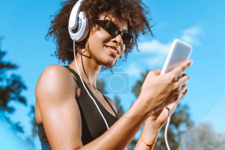 Sportive african-american woman in headphones