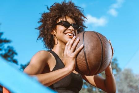 African-american woman throwing basketball