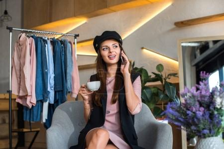 Girl talking on smartphone in boutique