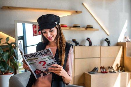 girl reading business magazine