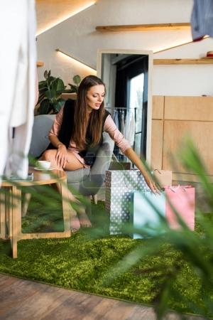 girl with shopping bags in boutique