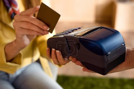 Woman paying by credit card and terminal