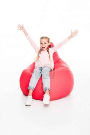 excited child with raised arms