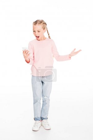 Photo for Young child looking at smartphone screen and looking dissatisfied, isolated on white - Royalty Free Image