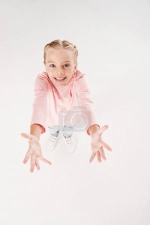 child with arms raised up