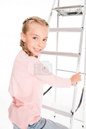 child with metal ladder