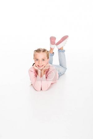 Happy child lying on floor