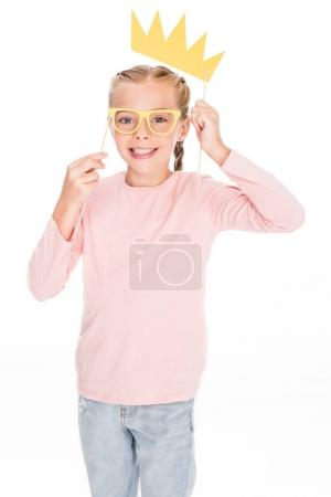 child with cardboard glasses and crown
