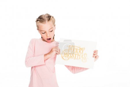 Shocked child with Merry Christmas card