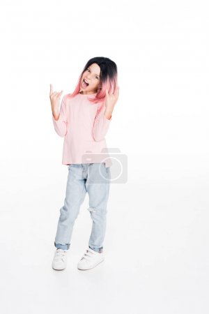 kid showing rock sign
