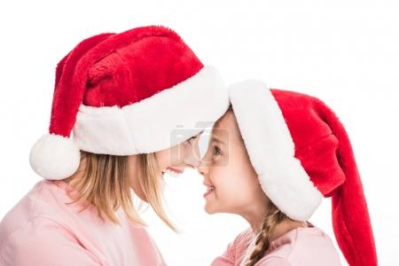 Mother and daughter in santa hats