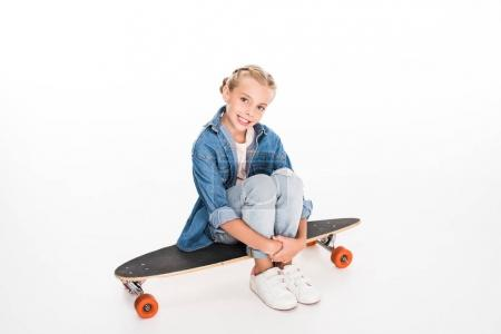 little skateboarder on longboard