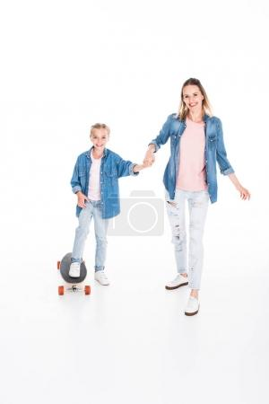 Daughter skateboarding on longboard
