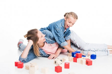 mother and daughter with aphabet blocks