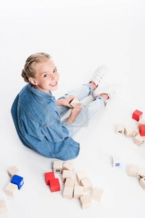 child with aphabet blocks