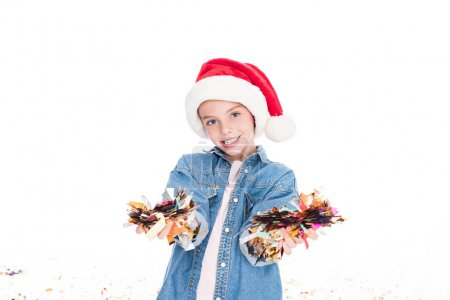 child with confetti on christmas